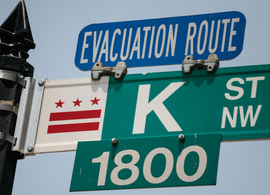 Shelter Location and Evacuation Route Assignment Under Uncertainty: A Benders Decomposition Approach