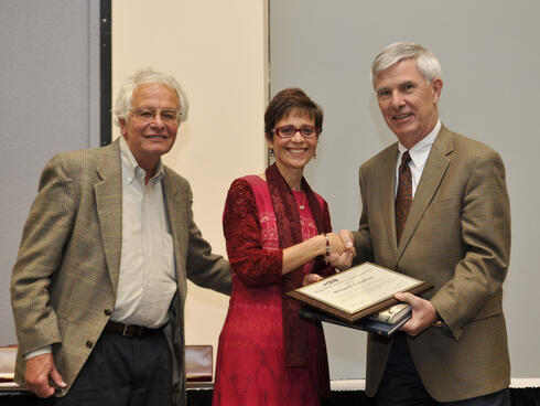 Morse committee member George Nemhauser and INFORMS President Rina Schneur present the Philip McCord Morse Lectureship to William R. Pulleyblank.