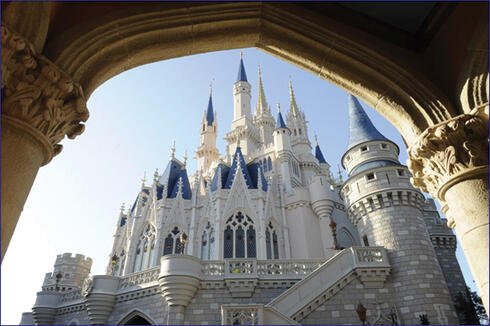 A unique side view of the iconic Cinderella Castle, centerpiece of the Magic Kingdom theme park