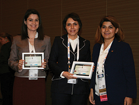 Yulia Vorotyntseva (left) and Monirehalsadat Mahmoudi (center) receive Monsanto Award.