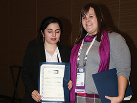 Nasim Nezamoddini (left) receives award.