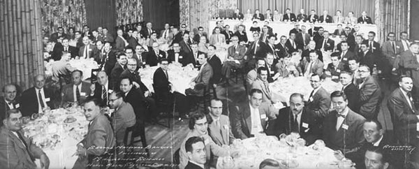 Meeting of the minds: The head table (rear of the photo) at TIMS' Second Annual Banquet, held in New York City in 1955, featured many of the profession's most notable pioneers including (left to right) Roger Crane, Ezra Glazer, George Kozmetsky, Herbert Simon (vice president), William Cooper (past president), Merrill Flood (president), Melvin Salveson, C. West Churchman, Gifford Symonds, Alex Orden, Andy Vazsonyi and David Hertz.