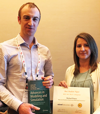 Winter Simulation Conference Best Student Paper Award Michael Pearce (left) receives award from Emily Lada.
