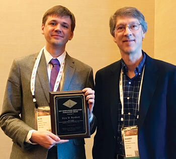 Outstanding Simulation Publication Award Ilya Ryzhov (left) receives award from Barry Nelson.