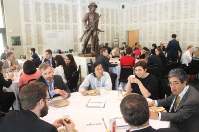 Summit participants exchange ideas during during lunch.