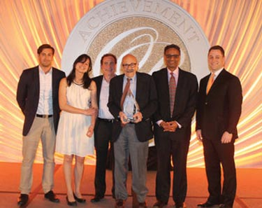 Al Blumstein (center, holding award), Ramayya Krishnan (second from right) and others celebrate Heinz School winning the UPS Prize.