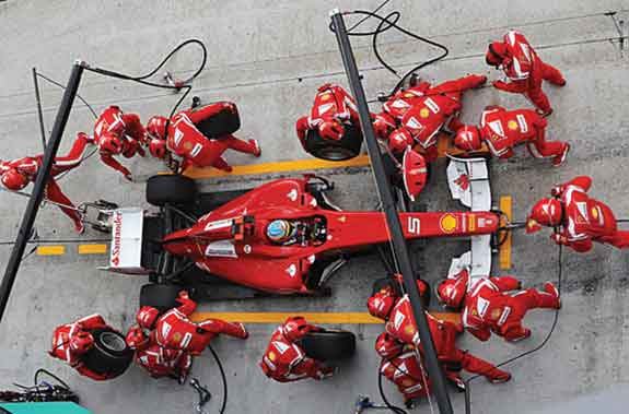 Quick stop: Optimized F1 pit teams can change four tires in two seconds.