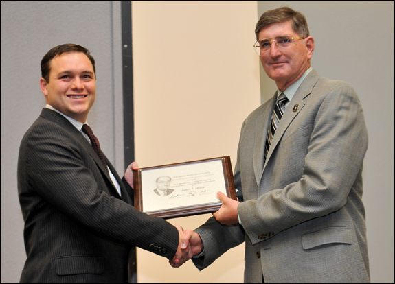 James Morris (left), recipient of the Bonder Scholarship for Applied O.R. in Military Applications, receives congratulations from Committee Chair Greg Parlier.