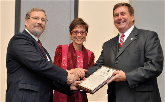 Incoming INFORMS President Terry Harrison (left) and 2011 INFORMS President Rina Schneur (center) congratulate Jeffrey Kline (right).