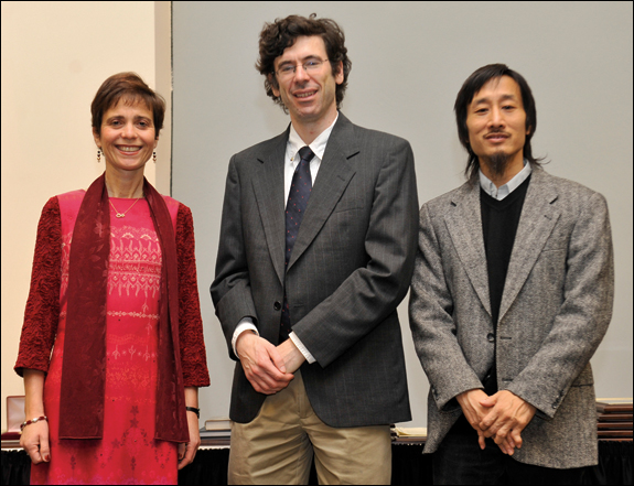 INFORMS President Rina Schneur and Committee Chair Michael Fu flank Lanchester Prize winner Jon Kleinberg. David Easley (not pictured) shared the award with his colleague, Kleinberg.