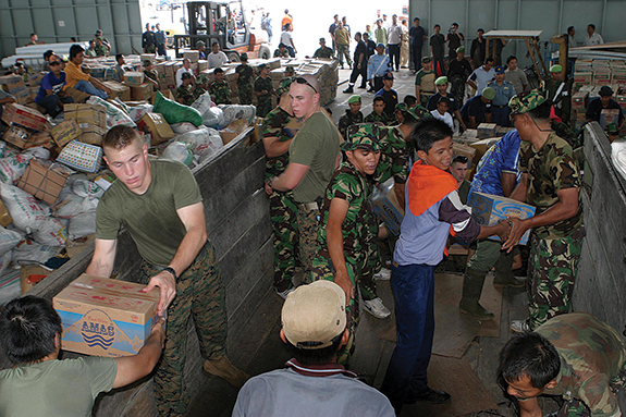 U.S. Marines help distribute humanitarian relief supplies at Palonia Air Field in Medan, Indonesia.