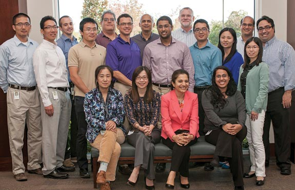 INFORMS member Pooja Dewan (sitting, third from left) leads BNSF's Operations Research and Advanced Analytics team.