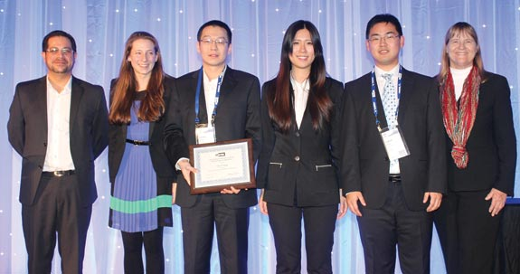 Chenxi Zeng (third from left) won the Doing Good with Good O.R. Student Paper Competition. Zeng is joined by Committee Co-Chair Ruben Proano (far left), INFORMS President Robin Keller (far right) and other finalists.