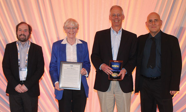Committee Chair David Shmoys (far left) and INFORMS President Ed Kaplan (far right) flank John von Neumann Prize recipients Ruth Williams and Marty Reiman.