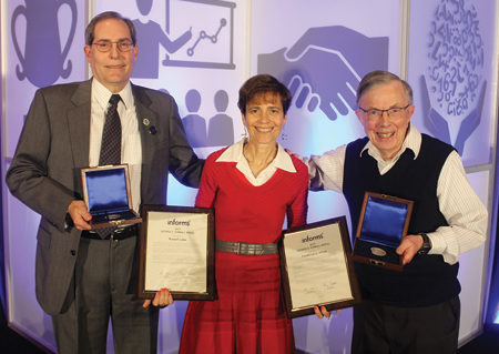 Kimball Medal presenter Rina Schneur (center) congratulates recipients Russell Labe (left) and Fred Hillier (right).
