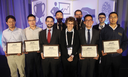 Nicholson Student Paper presenter Hayriye Ayhan (front center) is flanked by winner Andrew Li (right) and second-place finisher Bradley Sturt (left), along with other finalists.