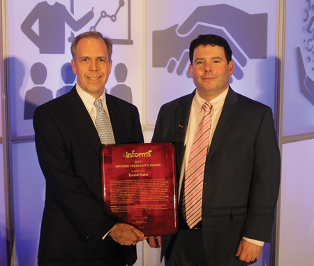 David Hunt (left) receives the INFORMS President's Award from Brian Denton (right).